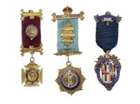 A group of fraternity medals