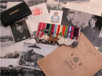 A group of medals with wartime paperwork