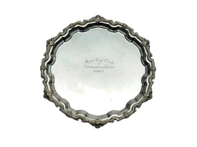 A silver tray with engraving