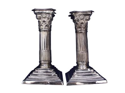 Two silver column candlesticks