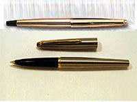 A gold Parker 45 fountain pen.