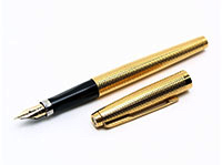 A decorative gold Parker 75 fountain pen.