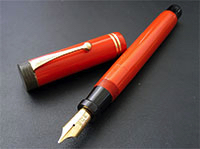 An orange Parker Big Arrow fountain pen.
