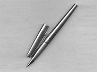 A stainless steel Parker Falcon fountain pen.